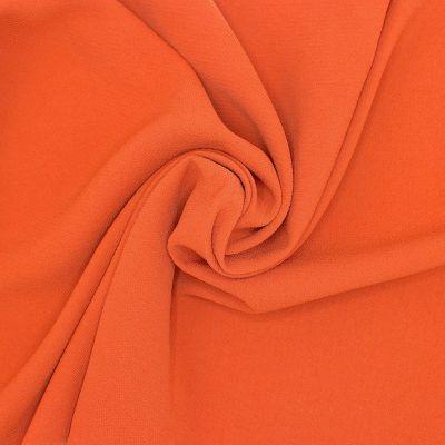Tissu aspect crêpe orange brûlée
