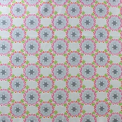 Tissu en coton à fleurs et oiseaux fuschia sur fond beige