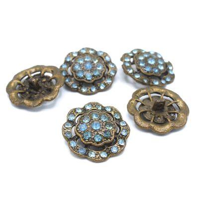 Bouton vintage en métal fleur à strasse bleu