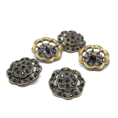Bouton métal fleur à strass noir