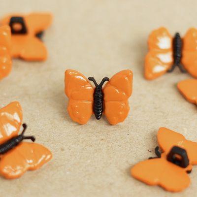 Bouton papillon en résine orange