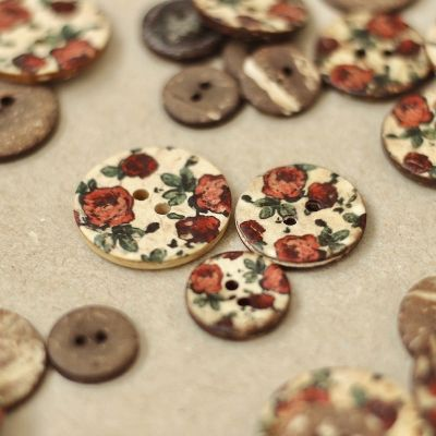 Wooden button with flower pattern