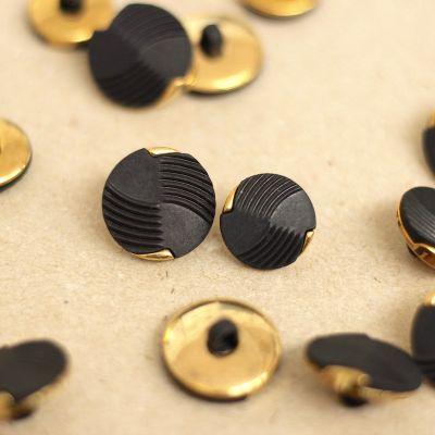 Bouton vintage noir et doré