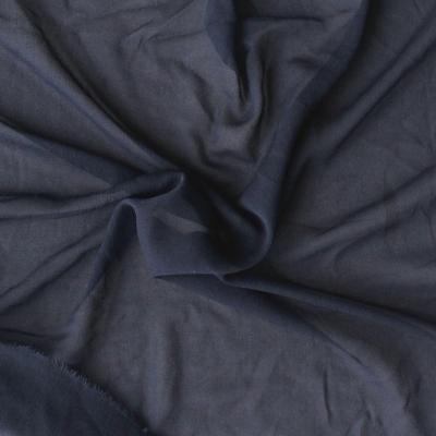 Zwarte sluierstof in zijde en elastaan