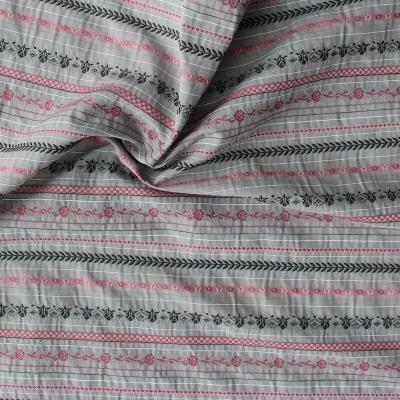 Tissu gris en coton, polyester et viscose à lignes et fleurs roses