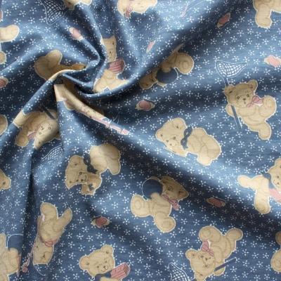 Tissu jersey en coton et polyester à oursons beiges sur fond bleu