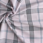 Black checked cotton fabric on pink background