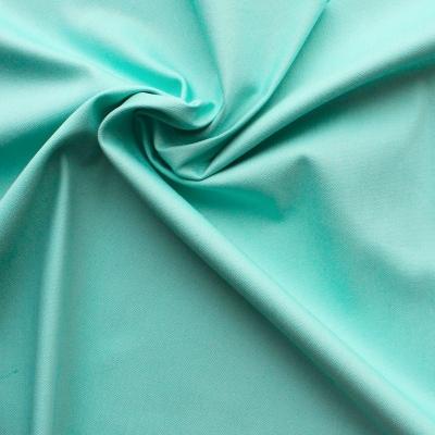 Tissu en coton, polyamide et élasthanne turquoise
