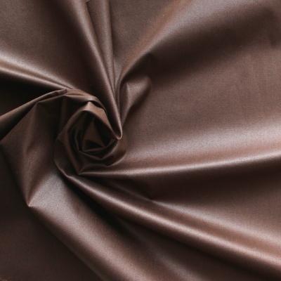 Tissu en coton et élasthanne brun effet waxé