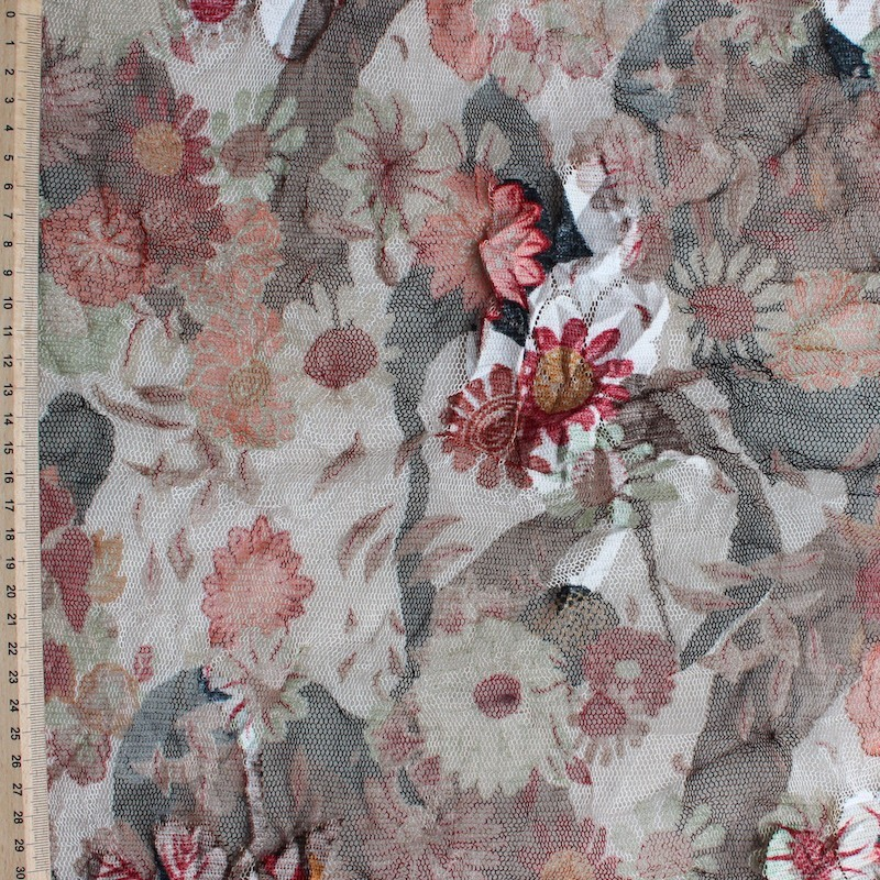 Polyester mesh fabric with red and black flowers on beige background