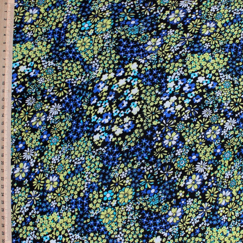 Jersey fabric of viscose and elasthanne with blue and yellow flowers  on black background