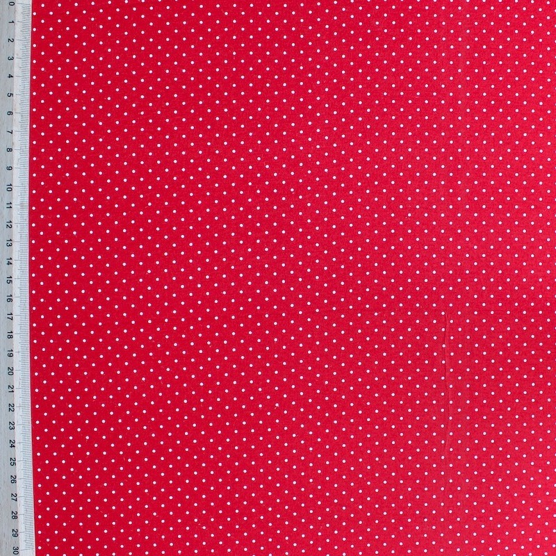 Jersey fabric of viscose and elasthanne with small white dots on red background