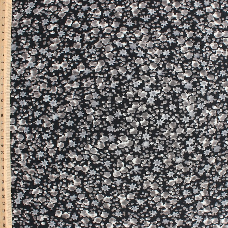 Jersey fabric of viscose and elasthanne with beige flowers on black background