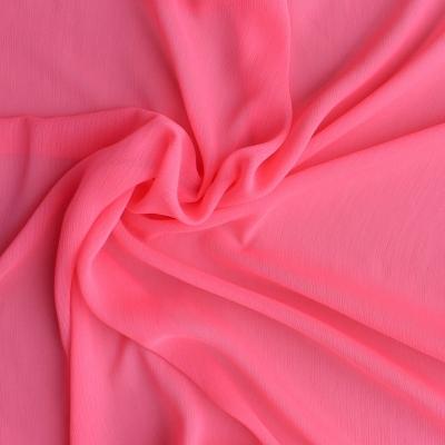 Voile froissé en polyester uni rose fluo