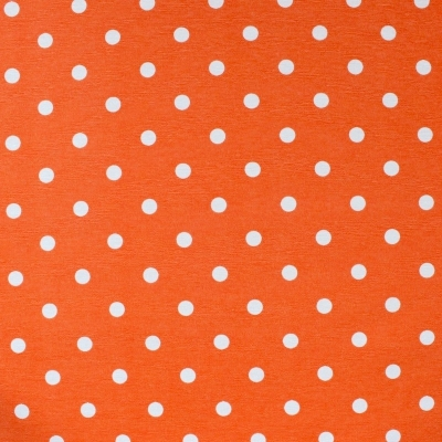 Cotton and polyester fabric with white dots on orange background