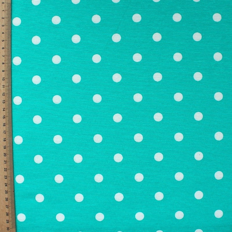Cotton and polyester fabric with white dots on blue background