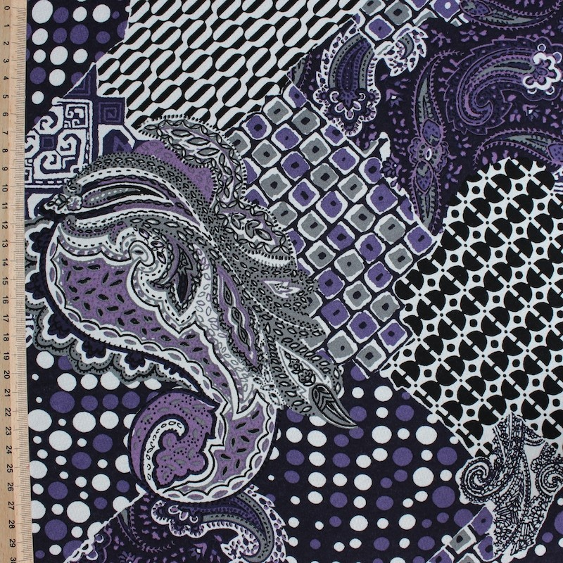 Polyester fabric with white and purple geometric design on black background