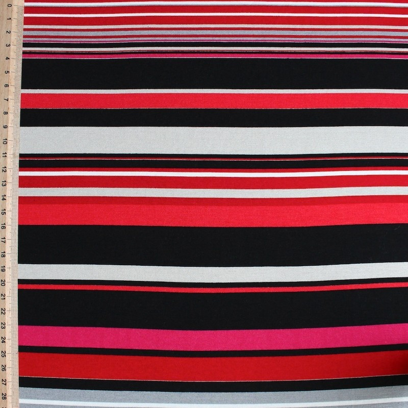 Jersey fabric of cotton, viscose and elasthanne with red, pink, green and yellow lines on black background