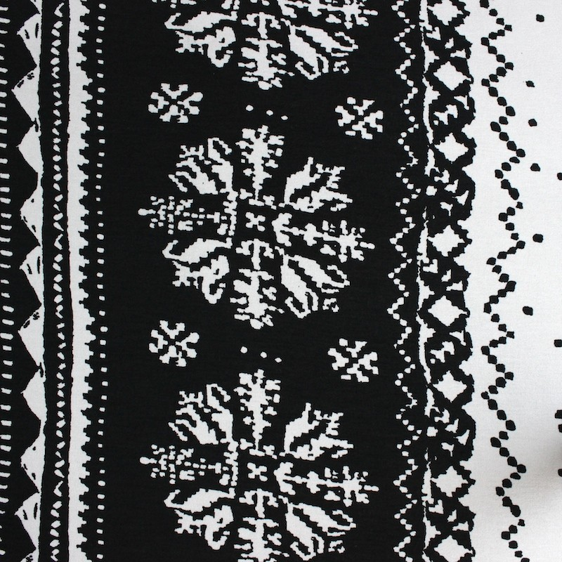 Viscose and elasthanne fabric with white geometric design on black background