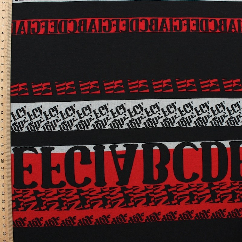 Jersey fabric of viscose and elasthanne with letters on red,grey and black background