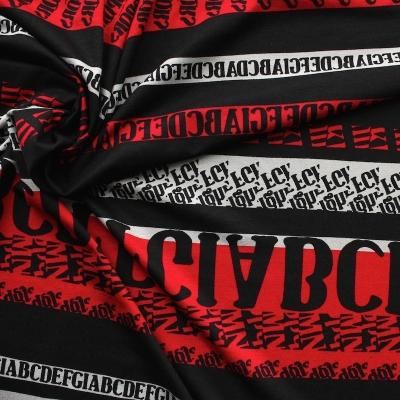 Tissu jersey en viscose et élasthanne à lettres noir sur fond rouge, gris et noir