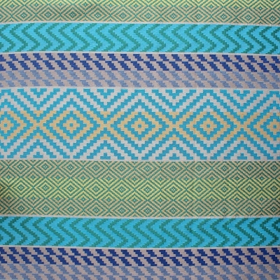 Cotton and polyester fabric with blue and green ethnic design on grey background