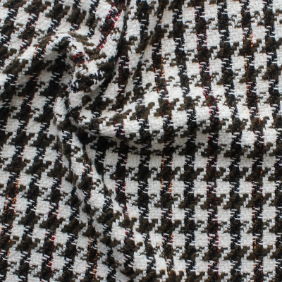 Wool, acrylic and polyester fabric with brown, white and black houndstooth design