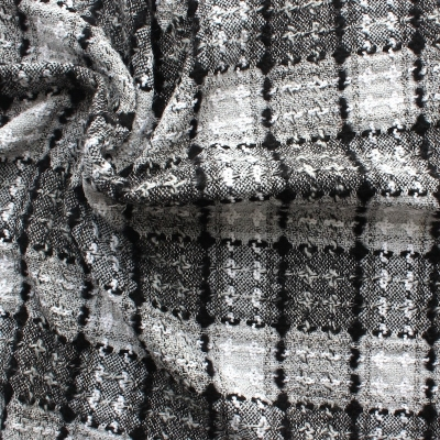 Viscose, wool and polyester fabric with black and white checkered design