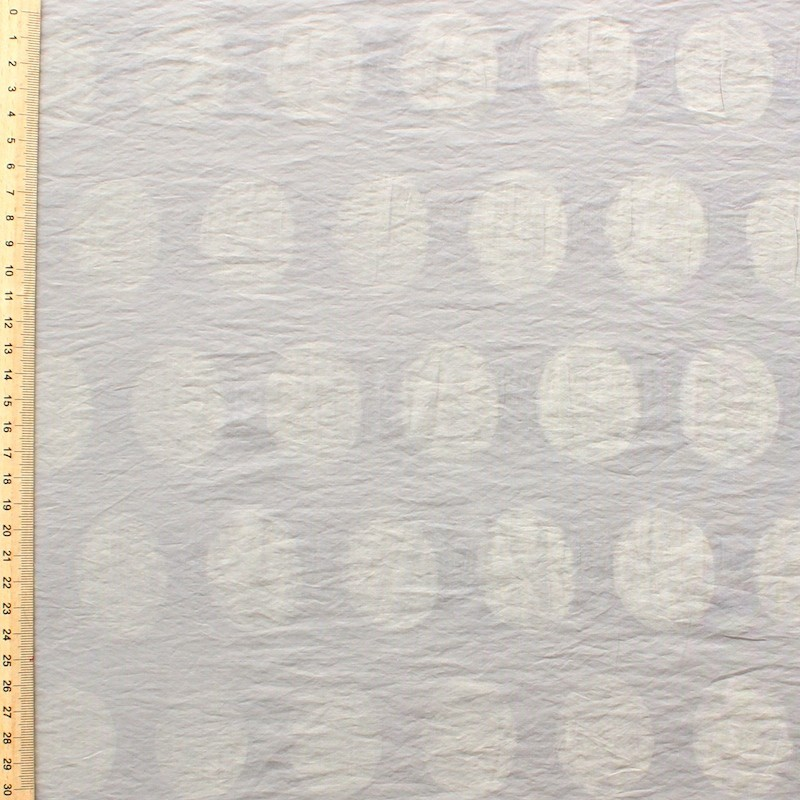 Cotton and polyamide fabric with dots on beige background