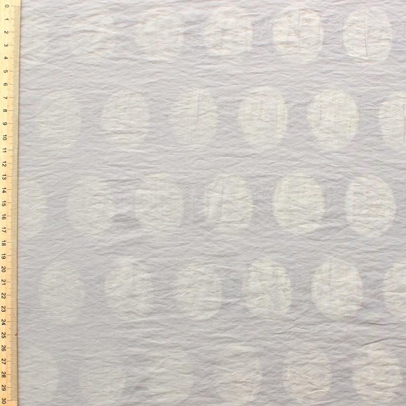 Tissu en coton et polyamide à pois sur fond beige