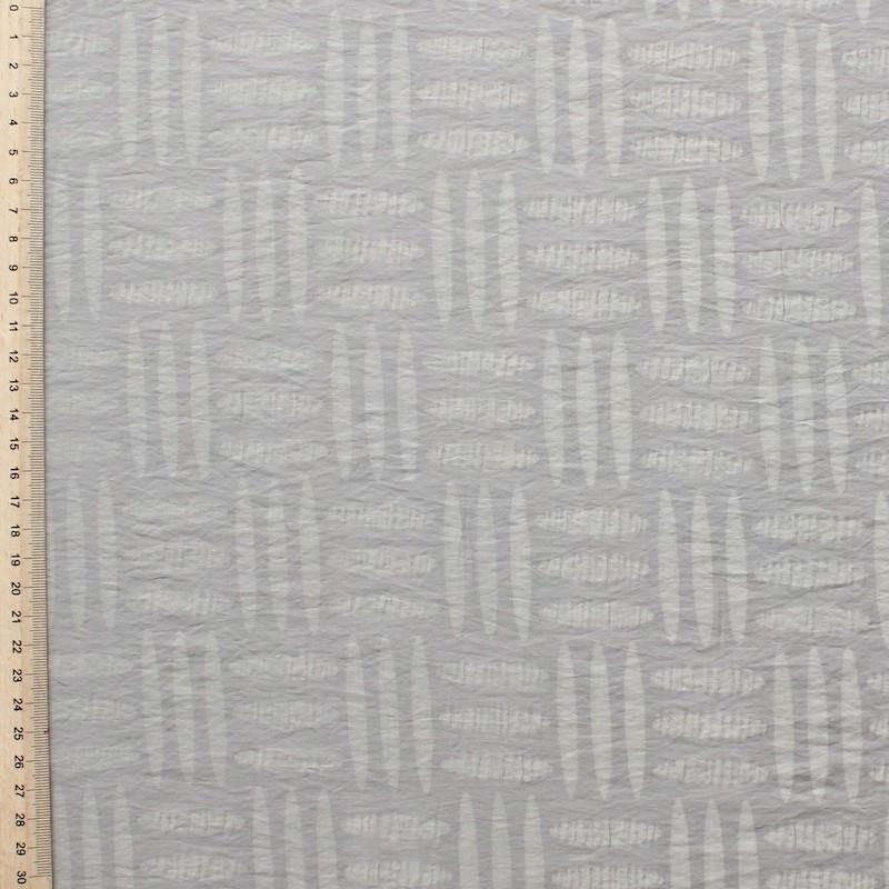 Polyamide en katoen stof met patroon op beige achtergond