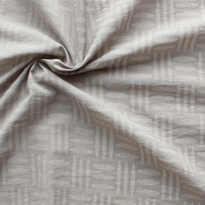 Cotton and polyamide fabric with designs on beige background