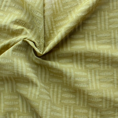 Cotton and polyamide fabric with stippen on green background