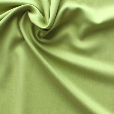 Groene Tencel en polyester stof