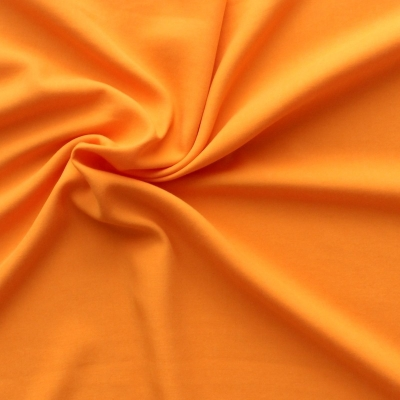 Tissu en Tencel et polyester uni orange