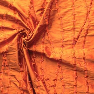 Orange silk with orange embroidered design