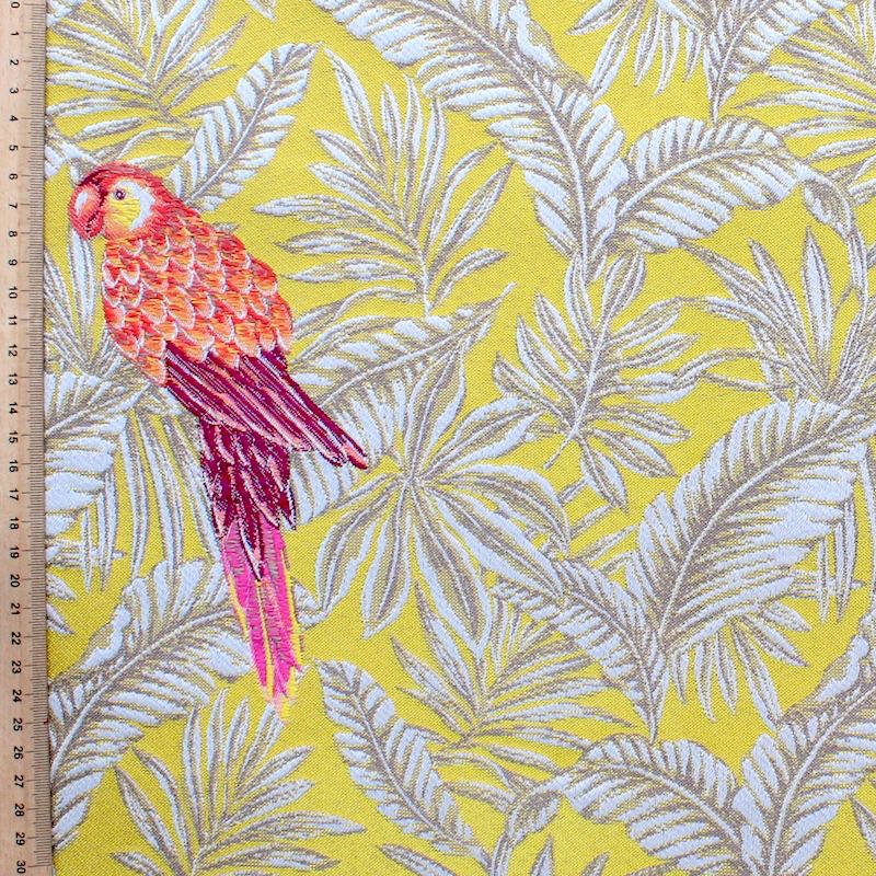 Polyester fabric with pink parrots and beige leaves on yellow background